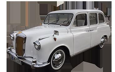 White convertible London Taxi