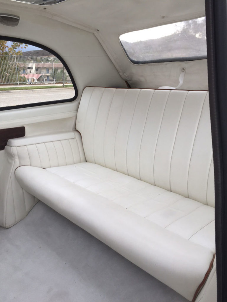 Rear interior shot of white London Taxi