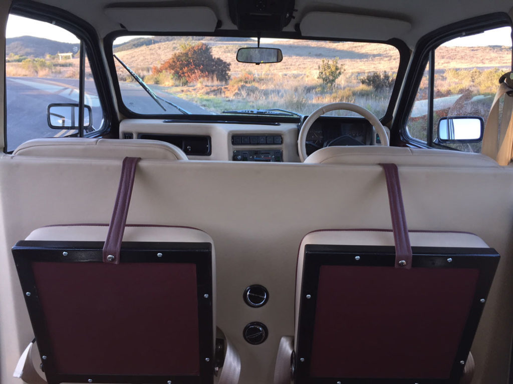 Rear compartment fold-down seats up