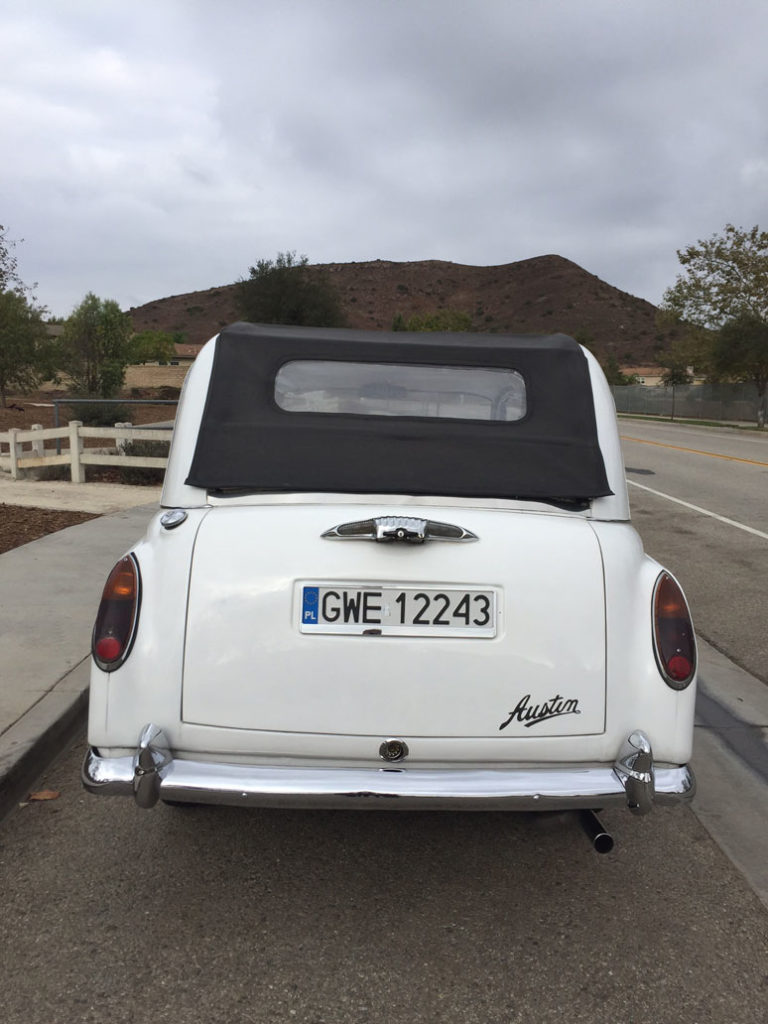 Rear view of white London Taxi