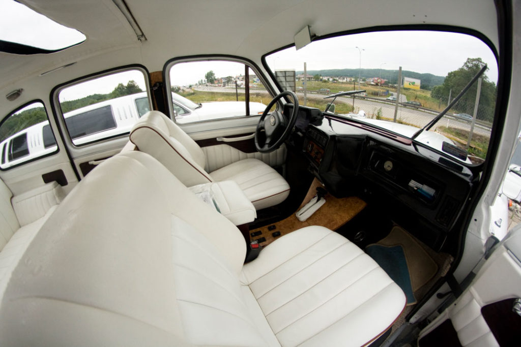 Fish eye view of interior of white London Taxi