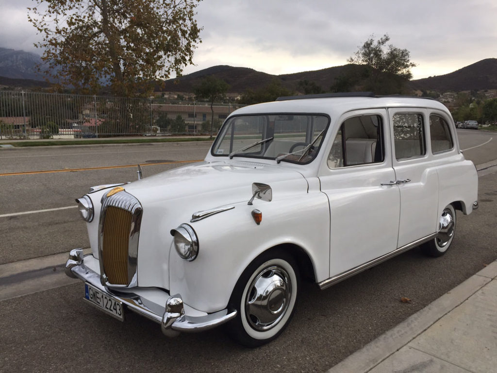 Full view of white London Taxi