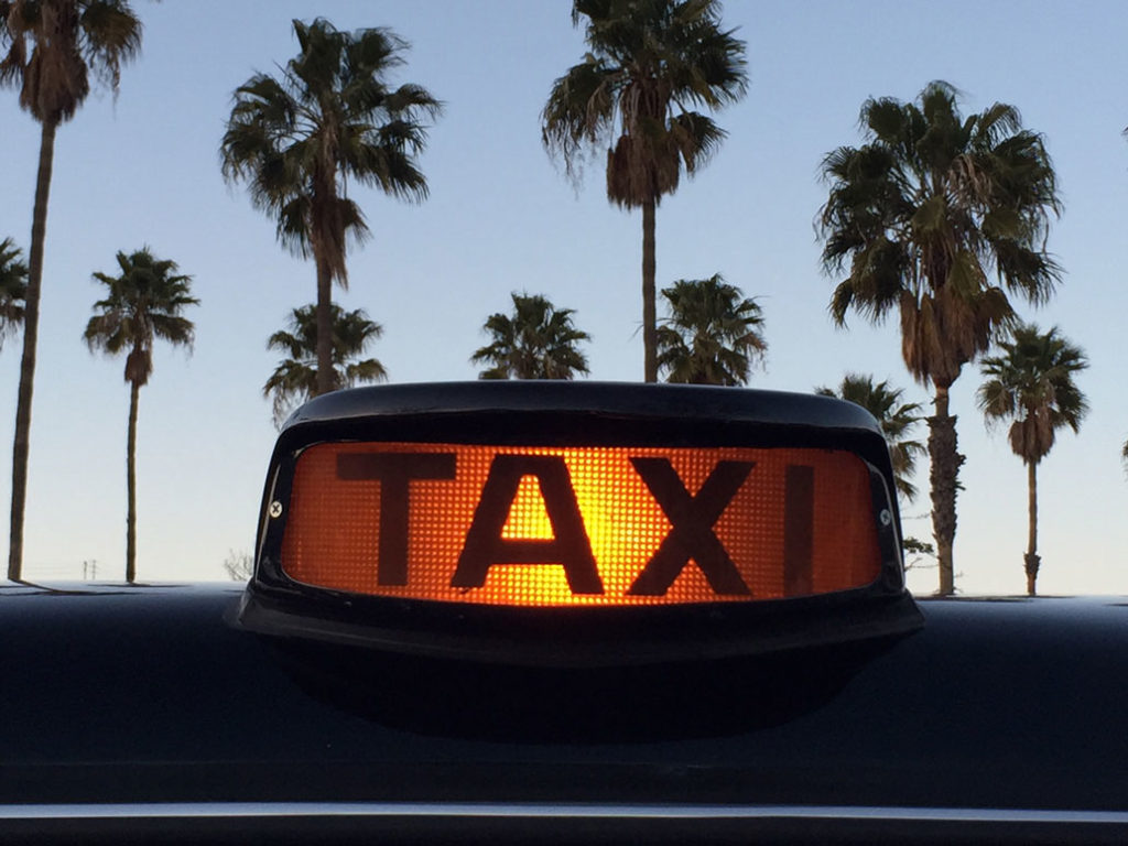 Roof-mounted taxi sign lit up